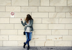 Against The Rules (CoolMcFlash) Tags: person woman smoker smoking cigarette copyspace wall forbidden nosmoking canon eos 60d frau rauchen zigarette verbot wand verboten fotografie photography standing stehen sigma 1020mm 35 humor