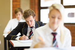 high school students sitting in classroom (alchemytuition) Tags: students highschool boys girls female male portrait uniform middleschool school class education classroom classmates studying learning desk sitting closeup happy smiling cheerful cute pretty beautiful young youth adolescence adolescent white caucasian teens teenagers teenage brunette tie formal smart books indoors pen writing southafrica