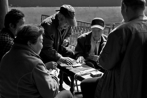 Old men playing cards at the Temple of Heaven, Beijing, China