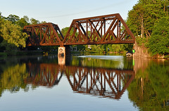 Railroad Bridge Over Erie Canal (dr_marvel) Tags: pittsford ny newyork rochester water waterway canal eriecanal erie bridge railroad rust steel reflections