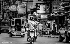 Thai streets (RoManLeNs) Tags: street people busy motorcycle tuktuk blackandwhite desaturated roads speed thailand asia moto traveling transportation romrom rom romanlens
