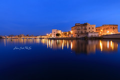 Musica all'ora blu (Antonio Ciriello PhotoEos) Tags: taranto puglia apulia italia italy tarantocittàspartana tarantovecchia cittàvecchia cittàspartana spartancity spartan city seascapes nightscapes night orablu bluehour blue landscapes paesaggimarini paesaggio reflectionsù riflessi picoftheday canon 5dmarkiv markiv eos5dmarkiv 5d canoneos5dmarkiv canon1635f4 1635 1635f4 longexposure lungaesposizione ngc