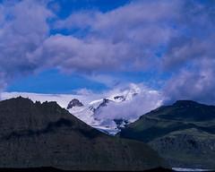 The Glacier hiding in the Skaftafell National Park (JaZ99wro) Tags: exif4film iceland film e6 velvia50 tetenal3bathkit islandia opticfilm120 pentax67ii glacier f0350 analog clouds