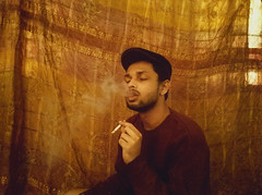 Cigarette (Self Portrait) (aimanaiman170) Tags: brown light natural ambient male smoker smoking cigarette smoke indoor