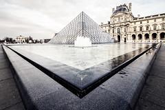 Make a choice (Michael Muraz) Tags: europe france iledefrance louvre paris world building city cityscape fountain museum muséedulouvre puddle pyramid pyramidedulouvre town water îledefrance