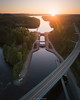 Crossing. (laurilehtophotography) Tags: suomi finland laukaa kuusaa road bridge dam sunset nature landscape water reflections lake forest trees dji mavic pro fc220 aerial photography amazing europe view horizon urban summer evening sun light shadows