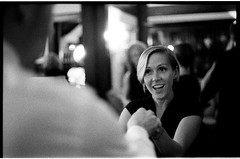 SusannahMichaelWedding_381 (Johnny Martyr) Tags: weddingphotojournalistmaryland weddingphotography weddingphotographer weddingphotographerfrederickmd wedding reception weddingreception smile blonde dance girl woman swing perspective overtheshouldershot dancing party blackandwhite bokeh bw availablelight availablelighting beautiful cute dark dim 35mm 35mmfilm 3200 3200iso existinglight film filmphotographer grain grainy ilford ilforddelta3200 ilford35mmfilm johnnymartyr johnnymartyrphotography johnnymartyrfilm kodak kodakhc110 kodakhc110b hc110b 6400iso primelens lowlight manualcamera manual maryland naturallight noflash naturallighting pushprocess pushprocessing wwwjohnnymartyrcom eyes baltimoremd baltimore gramercymansion