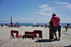 Untitled (ajkpix) Tags: beach sand ocean water summer umbrellas color street candid california sonnartfe2835 carlzeiss
