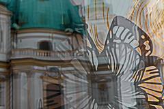 ....opposite.... (christikren) Tags: opposite gegensatz gegenüber visavis reflections austria architecture decoration glass kirche vienna church light christikren city classic modern weeklythemes opposites two blurred urban golden peterskirche