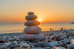 Zen Pebbles on a beach sunset (arnaud_martinez) Tags: beach people relaxation sun sunset calm calming five inspiration meditation orange pebbles pure relaxing sea sly stack stones sunrise walk waves yoga zen