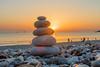 Zen Pebbles on a beach sunset (arnaud_martinez) Tags: beach people relaxation sun sunset calm calming five inspiration meditation orange pebbles pure relaxing sea sly stack stones sunrise walk waves yoga zen