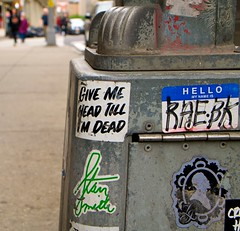 SOHO-Give me head... (plutohead) Tags: soho sohonewyork sohonyc graffiti sticker stickerart nyc