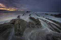 Land of dragons (explore) (Rafael Díez) Tags: españa paisvasco vizcaya barrika dragon paisaje mar agua atardecer sunset sol nubes rocas rafaeldíez filtro