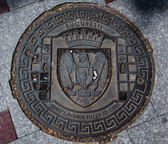 2018 - Romania - Bucharest - EUROTOP D400 (Ted's photos - For Me & You) Tags: 2018 bucharest nikon nikond750 nikonfx romania tedmcgrath tedsphotos vignetting bucuresti manhole manholecover cover street streetscene bucurestiromania cigarette cigarettebutt