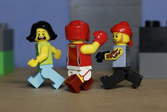 The Lady Kick-boxer has come to the rescue (N.the.Kudzu) Tags: tabletop lego minifigures woman kickboxer thug canondslr canoneflens macro flash primelens