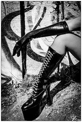 A Day Off (ViTaRu) Tags: canon 6d 1635mmf28l woman boots heels gloves pvc latex sexy graffiti blackandwhite bw monochrome laces fishnet contrast noir arm leg mood