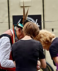 TheHuddle (Hodd1350) Tags: dorset wimborne wimborneminster wimbornefolkfestival backs people hat feathers talking huddle black morrisdancers sonya7rlll zeissbatis135mmlens