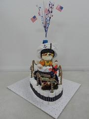 Boat diaper cake (Thong Bartlett) Tags: diapercake boat pirate babyshower redblueandwhite life preserver starsspangled target hobbylobby ebay nautica godblessamerca