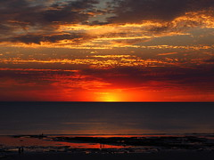 Almost gone! (Digidoc2 - OFF for a little while!) Tags: sunset dramaticsky dusk twilight sun silhouette evening backlit ocean indianocean beach rocks sand shoreline reflections water people waves clouds landscape seascape