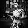 Gloves (Kieron Ellis) Tags: candid woman gloves carry holding books earring street blackandwhite blackwhite monochrome