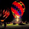 Light Up The Night (Wes Iversen) Tags: balloonglow balloonsoverbavarianinn frankenmuth hss michigan nikkor18300mm sliderssunday children colorful fire flame hotairballoons lights men people pickups trucks women