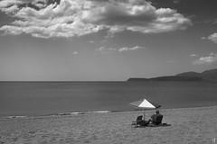 Relaxing... (tzevang.com) Tags: beach bw bythesea bwseascape sun greece mani clouds fujifilm x100f relax