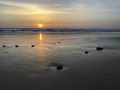 Closing the chapter for a new day (Smcabel) Tags: sunset beach rocks waves calm color yellow orange blue white sky oregon newport newportbeach ocean sun