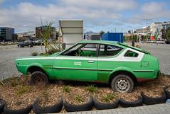 Greening the Rubble (Jocey K) Tags: newzealand nikond750 christchurch architecture buildings cars clouds sky cbd car art greeningtherubble eastframe van tires plants