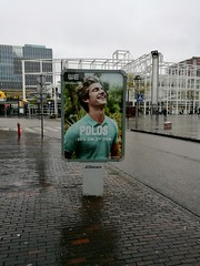 Advertisement for polo shirts while the weather is cold and wet (Michiel2005) Tags: reclame ad advertisement polo poloshirt jongen man stationsweg stationsplein leiden nederland netherlands holland