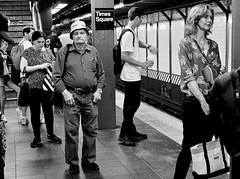 the long wait (susanjanegolding) Tags: xpro2 123subway monochrome blackandwhite trainstation trainplatform infastructure publictransportation timessquaresubwaystop timessquare subwaystation newyorkcitysubway subway 7thavenueirt