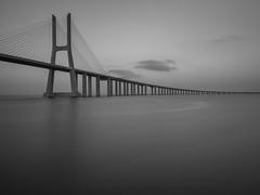 The Passing of Time (Wizard CG) Tags: long exposure bw black white mono fine art photography vasco da gama lisbon portugal architecture bridge sky monochrome lines epl7