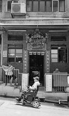 (perryge) Tags: hongkong urban city streetphotography candid people blackandwhite film berggerpancro400 hc110 leicam6 zeisszmbiogont35mmf28 wheelchair oldman three door building architecture sheungwan