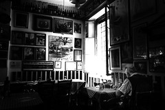 A lunch in the past (Giulio Magnifico) Tags: leica leicaq composition osteria osteriefriulane udine al vecchio stallo streetphotography street lighting light lunch food typical friuliveneziagiulia friuli man elder window restaurant