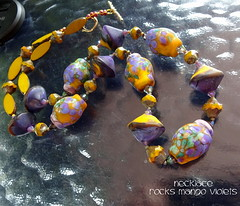 Necklace Rocks Mango Violets (Laura Blanck Openstudio) Tags: openstudio openstudiobeads murano glass jewelry handmade beaded lampwork beads fine arts art artisan artist made usa pendant colorful multicolor whimsical funky odd abstract asymmetric earthy organic one kind rocks nuggets pebbles stones contemporary urban bronce clasp artistic czech swarovski crystals necklace ocher yellow mustard suede opaque etched matte frosted grape plum lilac lavender violet purple green mango speckles coral neutral warm happy sunny tropical melon orange