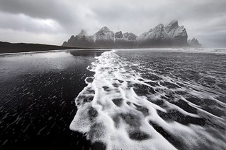Black beaches of Vestrahorn Mountain Iceland on a moody spring day.