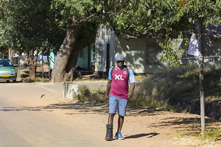 XL Man walking in Chinotimba