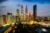 Cityscape of Kuala Lumpur Panorama at sunrise. Panoramic image of skyscraper at Kuala Lumpur, Malaysia skyline at dawn. (MongkolChuewong) Tags: architecture asia asian blue building business capital center city cityscape destination district downtown dusk evening famous home house kl klcc kuala landmark landscape lumpur malaysia malaysian modern night office panoramic petronas place reflection scene sky skyline skyscraper summer sunrise sunset technology tower towers travel traveler traveller twilight twin urban view
