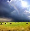 La quiete dopo la tempesta (Gio_ offline) Tags: quiete panorama italia italy sun clouds tempesta storm rainbow arcobaleno pianura pano field fields prato fieno luce light sky glow sunbeams lights