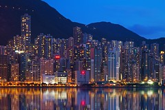 The Vertical City (UrbanCyclops) Tags: hongkong asia city urban metropolis skyline architecture building skyscraper tower mountains reflections victoriaharbour island reflection night lights cityscape landscape bluehour density