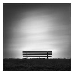 Simplicity III (Marco Maljaars) Tags: blackandwhite monochrome longexposure bench marcomaljaars bw minimalism air streaks clouds mood grass emptiness