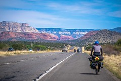 As we cycle near the edge of the Grand Canyon toward Sedona the red rocks start to appear.