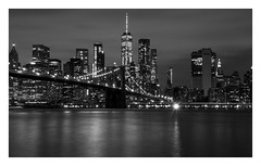 Brooklyn Bridge New York (mariolka3) Tags: architecture brooklynbridgepark manhattan classicview view worldtradecentre wtc skyscrapers buildings monochrome blackwhite longexposure clouds sky sunset skyline lights bridge water usa us city nyc newyork brooklynbridge