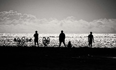 On the Beach  (Tahiti) (Harald Philipp) Tags: outdoors rural panorama seascape beach natural scenic people cyclist bicycle ocean sea lagoon water paradise holiday vacation tourism luxury tourist exotic destination travel adventure island beautiful romantic blackandwhite bw monochrome schwarzweiss grauzone nocolor dark shadows contrast tripod nikon nikkor d810 light day southpacific tahiti tahitian pacificocean clouds waves surf silhouette sunny frenchpolynesia polynesia