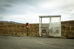 Waiting for the bus (Limned Light Photography°) Tags: bus station desert solitude loneliness mail chairs meadow sitting waiting wishing