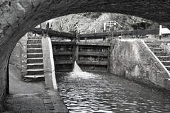 Springwell Lock (tatzlum.photo) Tags: bridge monochrome canal lock blackandwhite grandunioncanal springwell 50mm flickrfriday classic