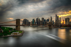 Brooklyn To Manhattan (Gary Walters) Tags: brooklyn bridge sunset water landscape sun nyc a7r ii a7r2 buildings cityscape park skyline east river city a7rii brooklynbridge eastriver pier