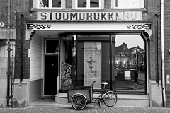 A Store (YY) Tags: dordrecht southholland netherlands bw blackandwhite street tricycle