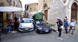 Traffic warden attending to traffic jam in Bevagna, Umbria