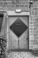 at the other side of that door (kceuppens) Tags: scooter antwerpen antwerp deur door mystery mistdrie black white bw blackandwhite wit zwart zwartwit zw nikon d7000 nikkor 35mm nikond7000 nikkor3518dx