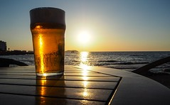 Sunset pint. (CWhatPhotos) Tags: cwhatphotos photographs photograph pics pictures pic picture image images foto fotos photography artistic that have which contain olympus camera holiday holidays hols hol june 2018 ibizan ibiza sunset sun set beer lager orange light color colour pint glass drink shadow silhouette silhouetted san antonio bay spain